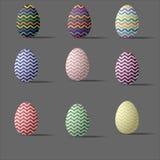 Sistema de nueve huevos de Pascua ondulados coloreados Fotografía de archivo libre de regalías