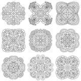 Sistema de nueve mandalas blancos y negros en un fondo blanco Imágenes de archivo libres de regalías