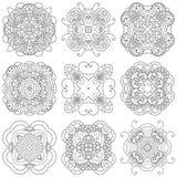 Sistema de nueve mandalas blancos y negros en un fondo blanco Imagen de archivo libre de regalías