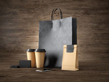 Sistema de panier negro, de tazas del arte, de paquete de papel, de tarjetas de visita en blanco y de smartphone genérico del dis Foto de archivo
