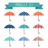 Sistema de paraguas planos lindos del otoño del estilo ilustración del vector