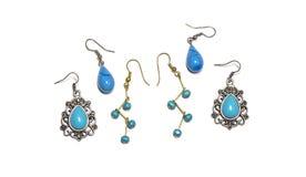 Sistema de pendientes de la plata y del oro con las gotas de la turquesa Imagen de archivo libre de regalías