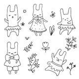 Sistema de pequeñas liebres lindas de la historieta Foto de archivo libre de regalías
