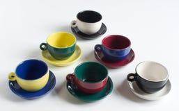 Sistema de pequeñas tazas coloridas Fotografía de archivo libre de regalías