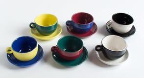 Sistema de pequeñas tazas coloridas Fotos de archivo