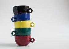 Sistema de pequeñas tazas coloridas Imágenes de archivo libres de regalías