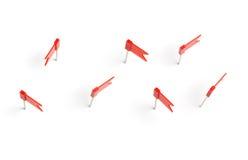 Pernos del empuje de la bandera roja Imagen de archivo