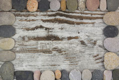 Sistema de piedras en una composición del marco Imagen de archivo libre de regalías