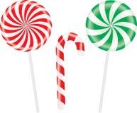 Sistema de piruletas espirales coloridas de los caramelos Vector Imagenes de archivo