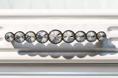 Sistema de plata de manijas de los muebles con las piedras en un fondo blanco imagen de archivo libre de regalías