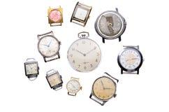 Sistema de relojes viejos aislados en el fondo blanco Fotografía de archivo