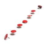 Tachuelas de pulgar rojas Imagenes de archivo