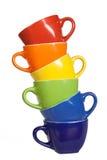 Sistema de tazas coloridas. Imagen de archivo libre de regalías