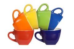 Sistema de tazas coloridas. Fotografía de archivo libre de regalías