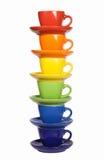 Sistema de tazas coloridas. Fotos de archivo