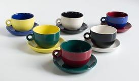 Sistema de tazas varicolored Fotos de archivo