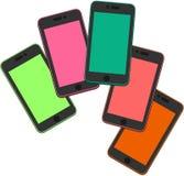 Sistema de 5 teléfonos móviles en diversos colores Imagenes de archivo