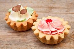 Sistema de tortas con crema de la mantequilla Fotos de archivo libres de regalías