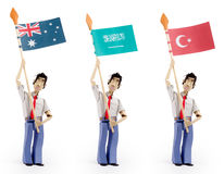 Sistema de hombres de papel que sostienen banderas Fotografía de archivo libre de regalías