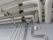 Sistema de tubo en lavadero Imagen de archivo