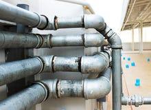 Sistema de tubos en el edificio Fotografía de archivo