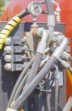 Sistema de tubos de la presión del excavador Foto de archivo