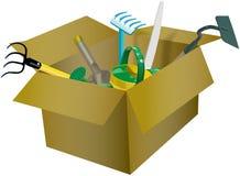 Sistema de utensilios de jardinería en la caja de cartón Foto de archivo libre de regalías