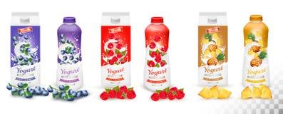 Sistema de yogur en botellas y cajas con la fruta y las bayas Imagen de archivo
