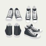 Sistema de zapatillas de deporte aisladas vector del negro de la historieta Imagen de archivo
