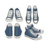 Sistema de zapatillas de deporte del azul de la historieta Imagen de archivo libre de regalías
