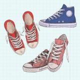 Sistema de zapatillas de deporte coloreadas Ilustración drenada mano Gumshoes en un fondo de una hoja de papel stock de ilustración