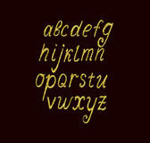 Sistema del alfabeto con brillo de oro Foto de archivo