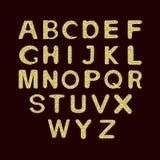 Sistema del alfabeto con brillo de oro Fotografía de archivo libre de regalías