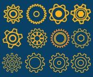 Sistema del diverso ejemplo de los engranajes con el fondo azul Foto de archivo