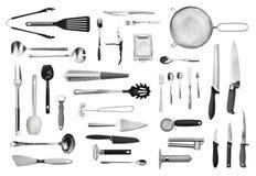 Sistema del equipo y de los cubiertos de la cocina Fotografía de archivo