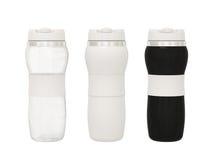 Sistema del frasco de agua plástico en un fondo blanco con el recortes Fotografía de archivo libre de regalías
