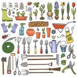 Sistema del garabato del jardín de la primavera Herramientas coloreadas, plantas Fotos de archivo