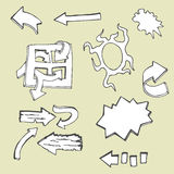Sistema del garabato del vector que dibuja flechas abstractas y símbolos Imagen de archivo