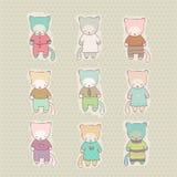 Sistema del gato lindo de la historieta vestido Fotos de archivo libres de regalías