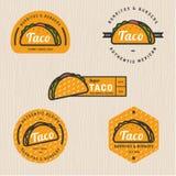 Sistema del logotipo del taco, insignias, banderas, emblema para el restaurante Foto de archivo