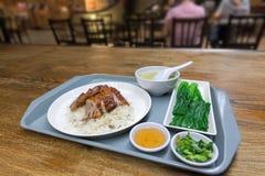 Sistema del plato del arroz del pato de carne asada y del cerdo de la barbacoa Fotografía de archivo libre de regalías