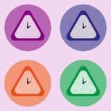 Sistema del reloj de cuatro triángulos en el fondo violado claro Foto de archivo libre de regalías