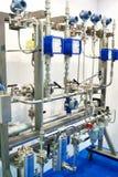 Sistema del ripetitore con i metri, i tubi ed i filtri immagine stock