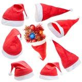 Sistema del sombrero rojo típico de Papá Noel aislado Foto de archivo libre de regalías