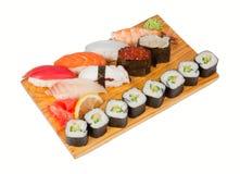 Sistema del sushi a bordo aislado en blanco Fotografía de archivo libre de regalías