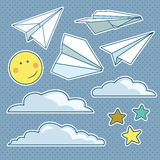Sistema del vector con los aviones de papel aislados, estrellas, luna, nubes Foto de archivo