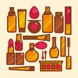 Sistema del vector de cosméticos de los iconos en un estilo plano Fotos de archivo libres de regalías