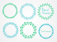 Sistema del vector de la mano floral dibujado alrededor de marcos imagenes de archivo