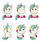 Sistema del vector de unicornios con diversos emoticons imagenes de archivo