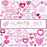 Sistema dibujado mano de corazones y de flechas Foto de archivo libre de regalías